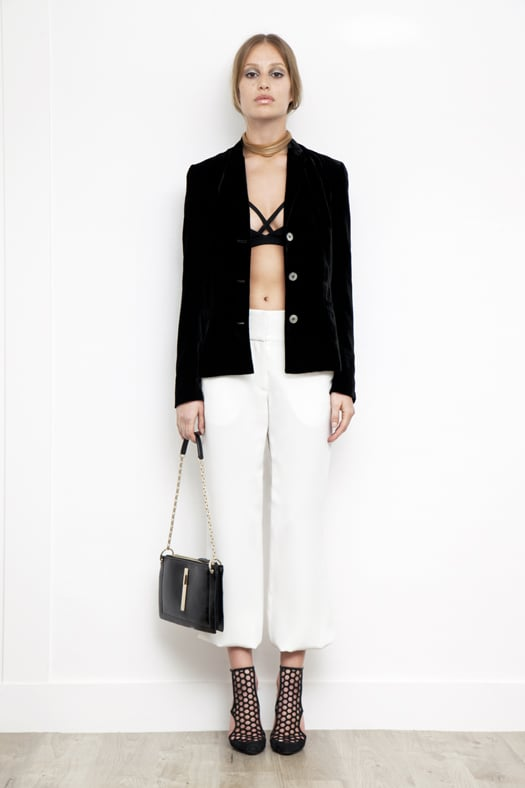 Viscose Sports Bra in Black, Velvet Short Blazer in Black, Elastic Bottom Silk Pant in Cream, Secret Place Patent Mesh Sandal Bootie in Black, Attraction Patent Shoulder Bag in Black. Photo courtesy of Tamara Mellon