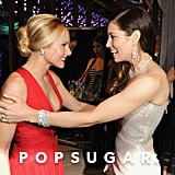 Jessica Biel and Kristen Bell grabbed on to each other.