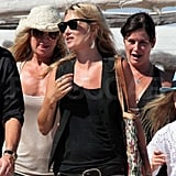 Kate Moss smiles and hangs out in the South of France.