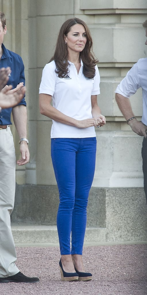Kate Middleton pulled off this sporty look with ease — just by adding Stuart Weitzman cork wedges and making sure her Zara jeans (similar style here, $36) had some interest (see next slide).