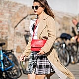 Dress up a plaid mini with a trench coat and button-down blouse for classic vibes.