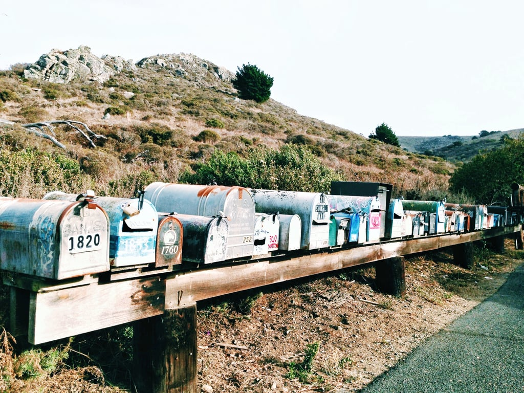 A mix of mailboxes marks the turn for Muir Beach.