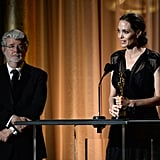 Angelina Jolie accepted an honorary Oscar, presented by George Lucas.