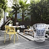 Wanting to avoid anything clunky, while still decorating with the comfortable pieces her husband Bryan loves, Jamie went with a mix of metal, rattan, and wicker furniture. It's inviting while being able to stand up to the elements.