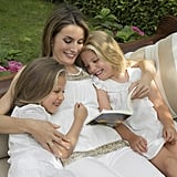 Letizia cuddled with her two daughters in September 2012.
