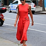 Wearing Red Suede Manolo Blahnik Pointed-Toe Pumps