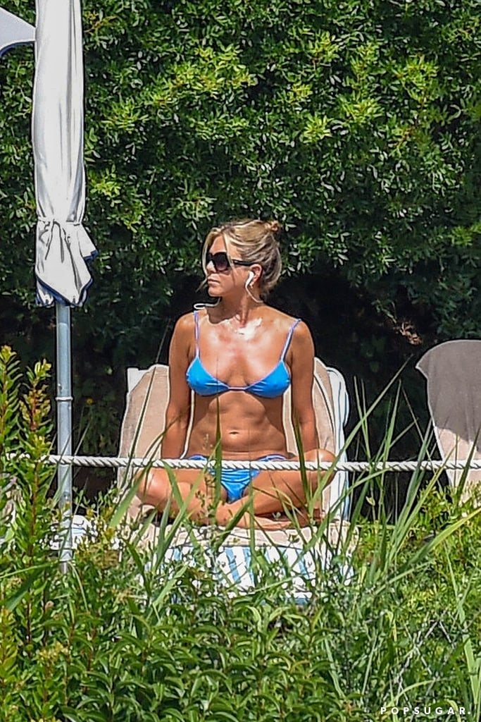 "Jennifer Aniston is currently in Portofino, Italy, filming her upcoming Netflix movie, Murder Mystery, with Adam Sandler, but on Sunday, the 49-year-old actress took a break to squeeze in a little poolside R&R. Jennifer showed off her fit figure in a bright blue bikini as she soaked up the sun and worked on her tan. Wow, doesn't she look incredible? Jennifer was also spotted doing some sightseeing with friends around the village.  Variety announced back in April that Jennifer would be partnering with Netflix for the first time ever for the film, which ""follows a New York cop (Adam) and his wife (Jennifer), who become prime suspects in the murder of an elderly billionaire while vacationing in Europe."" Jennifer and Adam previously starred in 2011's Just Go With It. But that's not all! Jennifer has also teamed up with Reese Witherspoon for an Apple TV series based on Brian Stelter's book, Top of the Morning: Inside the Cutthroat World of Morning TV. We hope Jennifer gets all the rest and relaxation she needs, because she definitely deserves it!       Related:                                                                                                           Age Is Just a Number! See Hot Stars Over 40 in Bikinis"