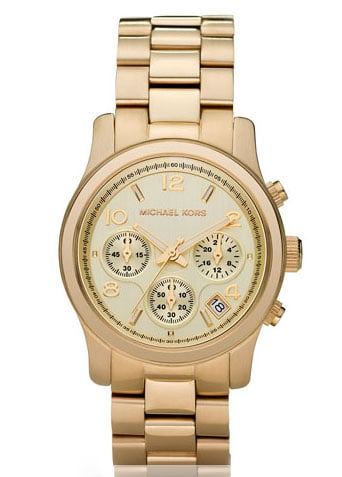 A luxe timepiece makes a perfect gift and will keep her running on schedule for job interviews, appointments, and all the happenings postcollege.  Michael Kors Midsized Chronograph Watch ($250)