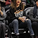 Rihanna's sporty-cool look is perfect for a basketball game — she wore skinny jeans and high-heeled boots with a slouchy sweater and camouflage cap to an LA Clippers game in January 2012.