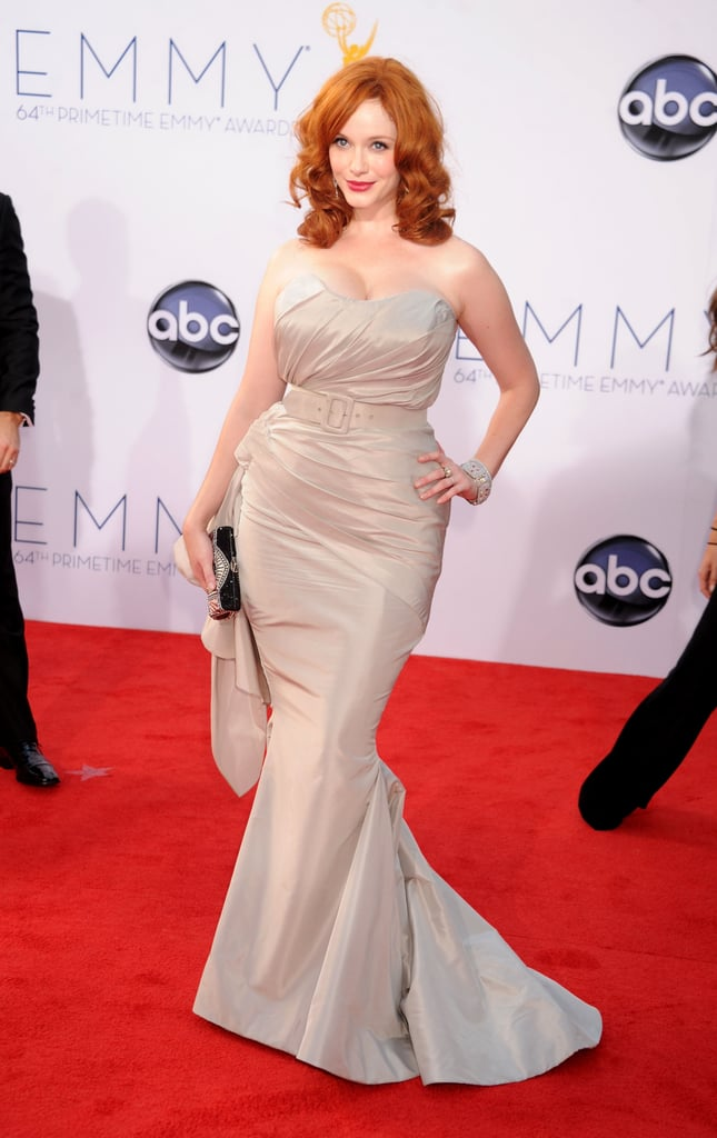 Christina Hendricks looked gorgeous on the red carpet in LA at this evening's Emmy Awards. She wore a strapless gown by Christian Siriano and had husband Geoffrey Arend by her side on her way into the show. Christina is up for outstanding supporting actress in Mad Men, while the series itself is nominated for outstanding drama. The show is just getting started, but first make sure to vote on all of our Emmys polls here!