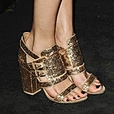 Then, the British beauty rounded out her already-embellished number with gold glitter sandals.