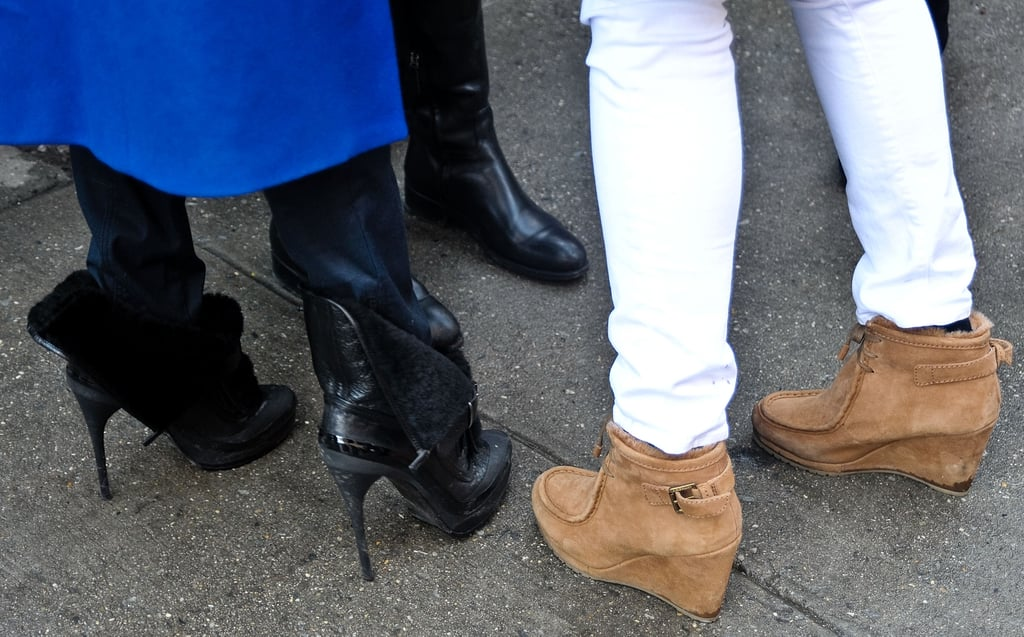 Two attendees with very different footwear agendas: at left, some high-wattage heels; at right, a pair of practical-cool moccasin booties.