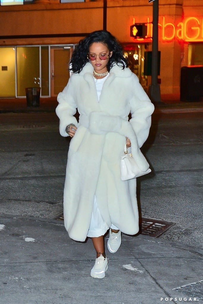 "Weeks after convincing us to buy UGGs, Rihanna is inspiring another cold-weather purchase with an oversize coat that doesn't not look like it was stolen from the Coca‑Cola polar bear. In all seriousness, the belted coat is actually from Céline's Pre-Fall 2018 collection — the last one Phoebe Philo designed for the brand before Hedi Slimane stepped in and hacked off the accent mark.  Rihanna accessorized the outfit she wore out in New York on Feb. 3 with a classic Fendi handbag, Stampd sneakers, and futuristic sunglasses by, yep, Rihanna herself. The singer and entrepreneur recently made headlines when she wore a similar pair of sunglasses with ""Fenty"" written on the side. Shortly after, Women's Wear Daily reported Rihanna was launching her own luxury fashion house. Will she continue to slyly wear her own designs without confirming the news or giving us any additional details? Probably! And we'll just continue to wait patiently. In the meantime, check out her latest look ahead and shop similar cozy coats.      Related:                                                                                                           Rihanna's Savage Valentine's Day Lingerie Will Melt Your Screen, So Shop Quickly"