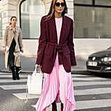 Go for a look that's equal parts flowy and tailored by choosing a dress with airy volume topped with a more sophistocated blazer to finish it off.
