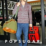 Liam Hemsworth caught a flight out of LAX.