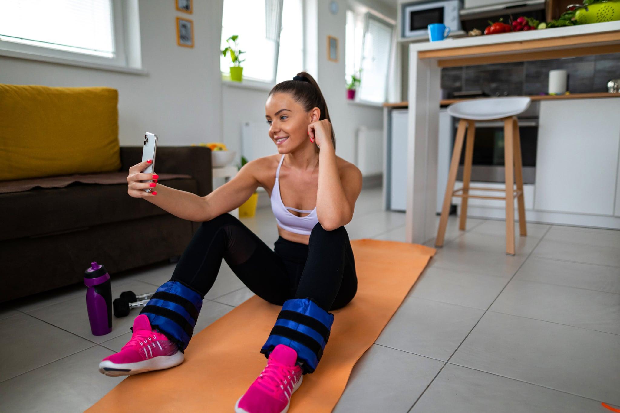 Woman using smartphone on break between exercise