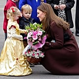 In this truly adorable moment, Kate knelt to speak to a little girl in a princess costume who greeted her with flowers in March 2013.