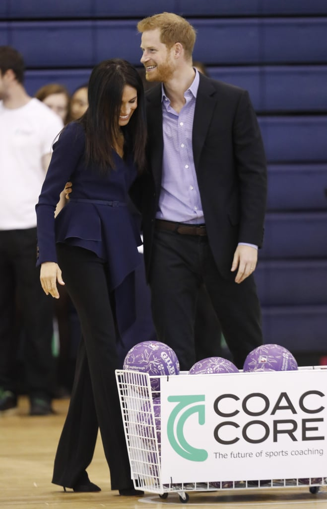 Prince Harry and Meghan Markle made another memorable appearance on Monday as they traveled to Loughborough, England, for the inaugural Coach Core Awards. Part of the Royal Foundation, Coach Core is an apprenticeship scheme that helps young people to build careers in sport. It was launched by Harry, alongside Prince William and Kate Middleton, back in 2012. Last year, the trio attended the graduation ceremony, but this time around, Harry brought his wife along instead, and they looked excited to meet members of the scheme and see how the program is evolving. Meghan has been very busy with her philanthropic duties of late. Last week, she launched her first solo project as a member of the royal family, Together: Our Community Cookbook, with the Hubb Community Kitchen. She hosted a lunch in the gardens of Kensington Palace, with her mom and husband by her side. On Tuesday, she will return to London to make her first solo official royal appearance, when she attends the opening of a new exhibition at the Royal Academy of Arts. We're excited to see her step out without Harry for the first time, but before that, we have one more loved-up appearance to swoon over. See all the pictures of the royal couple during their latest outing ahead, then get details on Meghan's top and her shell necklace.      Related:                                                                                                           What a Year It's Been! 23 Major Royal Milestones Prince Harry and Meghan Markle Hit in 2018