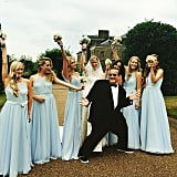 The bridesmaids' ethereal blue dresses were on display in this candid moment.