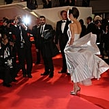 Marion Cotillard's dress billowed around her at the premiere of L'Homme Qu'On Aimait Trop.