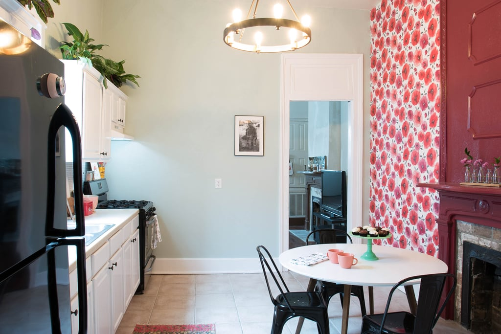 Bye bye, boring white walls! A vibrant red floral wallpaper enlivens the dining area while a beautiful chandelier ($169) make the entire space feel modern. Guests will want to sit down and stay a while at the new table ($401) and chair set ($171) Monica picked out.