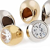 Goldtone or Silvertone Cocktail Ring with Clear Crystal, $95 each; Goldtone or Silvertone Dome Ring, $85 each