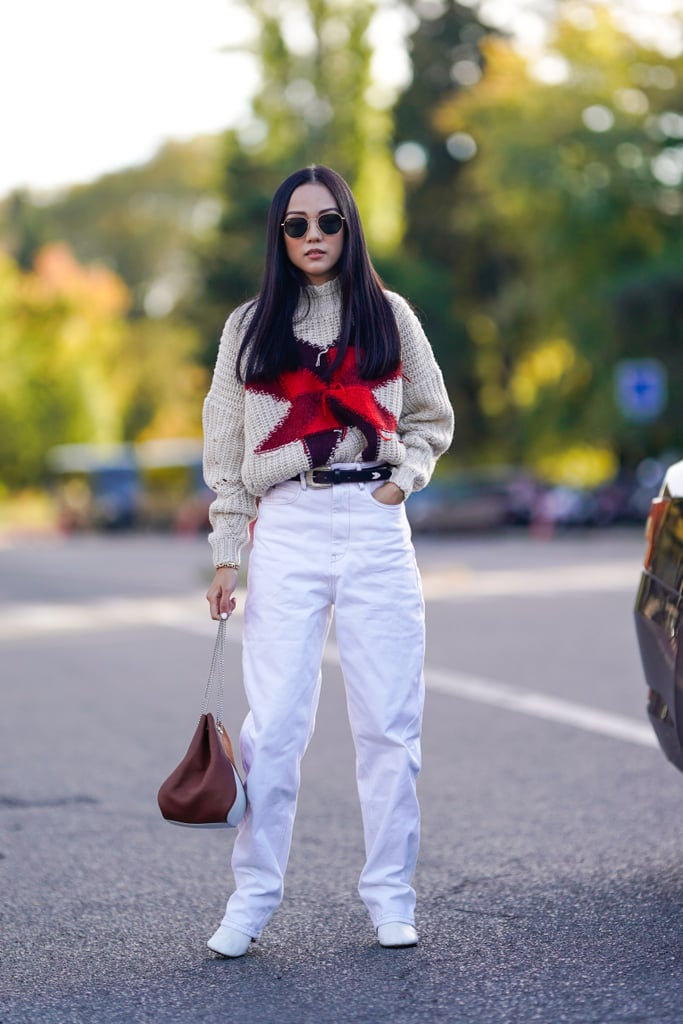 Cap Off Loose, Baggy Jeans With White Heeled Booties, Which Will Elongate the Legs