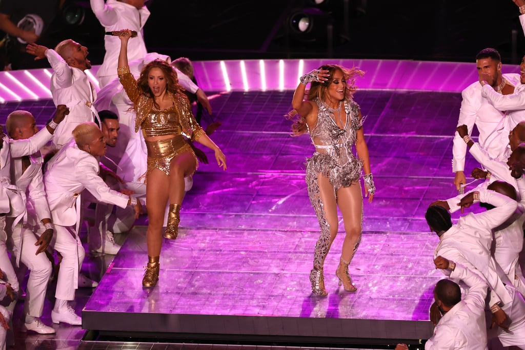 """If you're still reeling from the musical extravaganza that was the 2020 Super Bowl Halftime Show, same. On Feb. 2, Jennifer Lopez and Shakira took over Miami's Hard Rock Stadium for their joint halftime show and truly gave every previous performance a run for its money!  Shakira opened the show with her iconic jams """"She Wolf,"""" """"Wherever, Whenever,"""" and """"Hips Don't Lie,"""" as well as a remixed version of Bad Bunny and Cardi B, """"I Like It"""" with the rapper himself. Lopez took over for the second half of the performance, leading the crowd through some of her greatest hits, including """"Get Right,"""" """"Waiting For Tonight,"""" and """"On the Floor."""" The halftime show even featured a surprise appearance by Lopez's daughter, Emme, who sang during the final mashup of """"Let's Get Loud"""" and """"Waka Waka (This Time For Africa)."""" That's how you land your performance in the Super Bowl hall of fame!  Keep scrolling to see photos of the high-energy performance ahead!"""