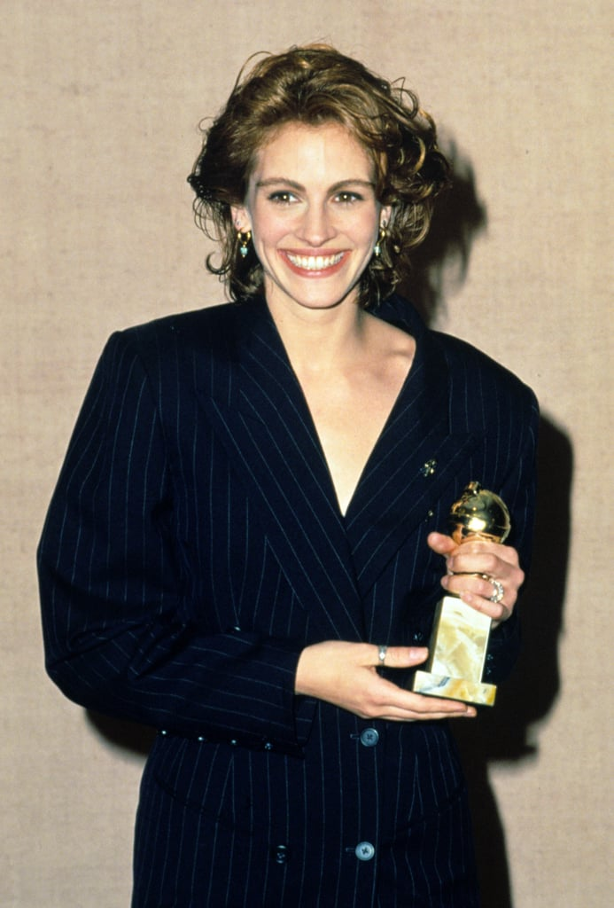 Julia's oversize pinstripe blazer could have a space in our closets today. She styled the look with sheer tights and gold drop earrings for the 1991 Golden Globe Awards.