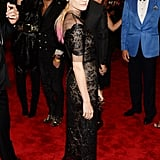 Diane Kruger was feminine in a black lace Chanel Haute Couture dress with a sheer overlay — but added a twist with the punky pink tips in her hair.