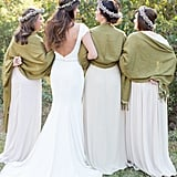 These bridesmaids topped their beige gowns with olive green shawls.