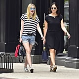 Dakota worked her cutoffs with a go-to striped t-shirt while out with a friend.
