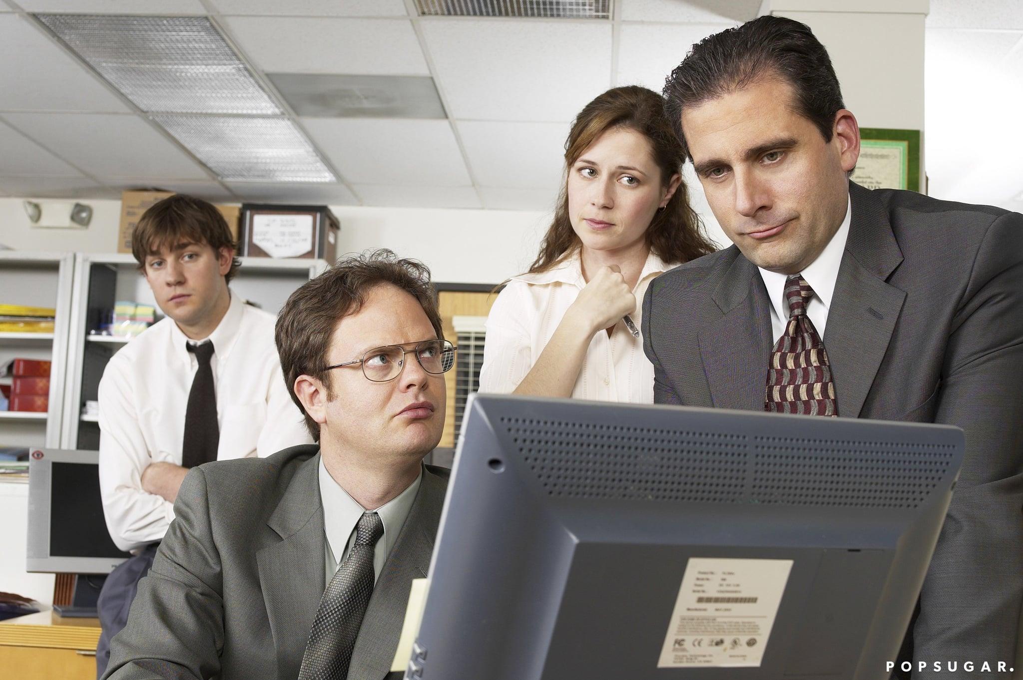 THE OFFICE -- Pilot -- Pictured: (l-r) John Krasinski as Jim Halpert, Rainn Wilson as Dwight Schrute, Jenna Fischer as Pam Beesly, and Steve Carell as Michael Scott-- Photo by: Chris Haston/NBCU Photo Bank