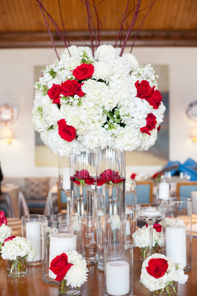 White floral arrangements with hints of red look just like lace from afar.