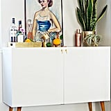 This Brittany Makes blogger managed to transform inexpensive Ikea cabinets into a swanky bar with retro appeal. Wait until you see the inside of the bar cabinet! Source: Brittany Makes