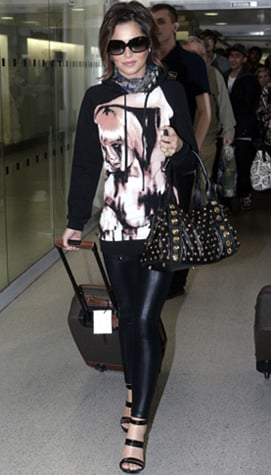 Photos of Cheryl Cole at Heathrow Airport in a Printed Hoody Dress
