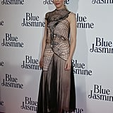 Cate Blanchett worked her curves in a sculpted Christopher Kane design and pointy-toe Louboutins at the Paris premiere of Blue Jasmine.