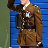 Prince Harry gave a salute during his visit to the naval base.