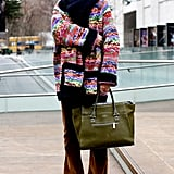 When you're bundled up, make it count with a statement coat and a luxe tote in tow, à la Natalie Joos.