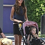 Victoria Beckham pushed Harper in her pink stroller while wearing flats.