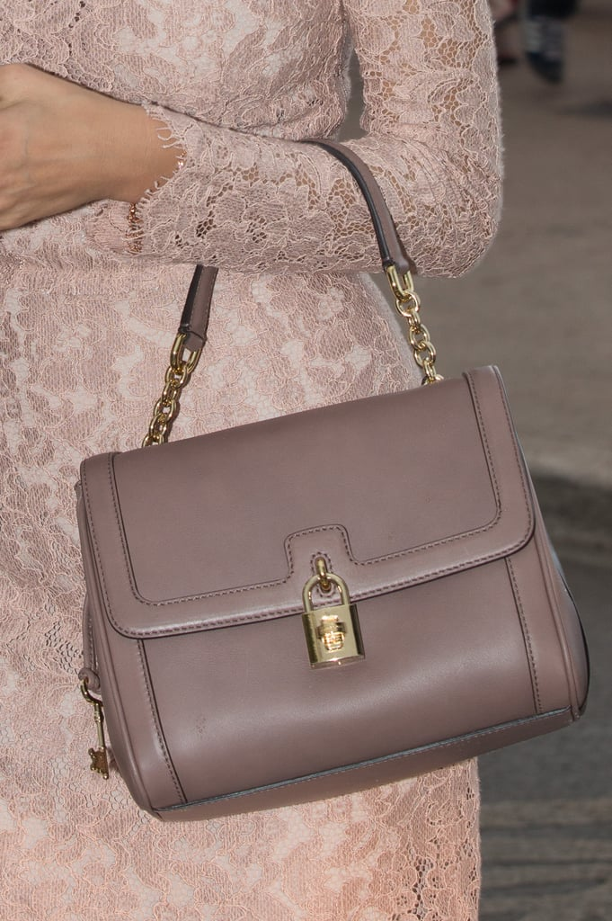 Petra Nemcova carried a taupe-colored leather bag.