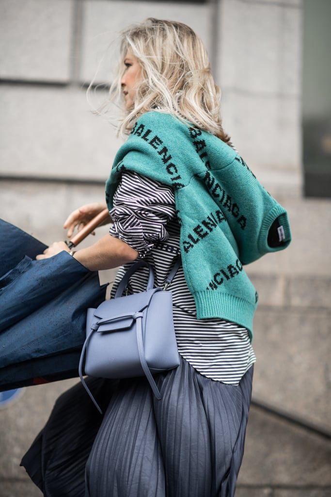 Add a sweater to your outfit to get in on the logo trend. Who says you have to wear your favorite designer on your bag when you can wear it on your sleeve?