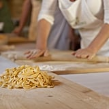 Unfold the strips, gently lay pasta in a pile, and sprinkle a touch of flour to prevent sticking.