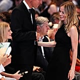 Hugo Boss CEO Claus-Dietrich Lahrs and Kate Bosworth talked during the Hugo by Hugo Boss show.