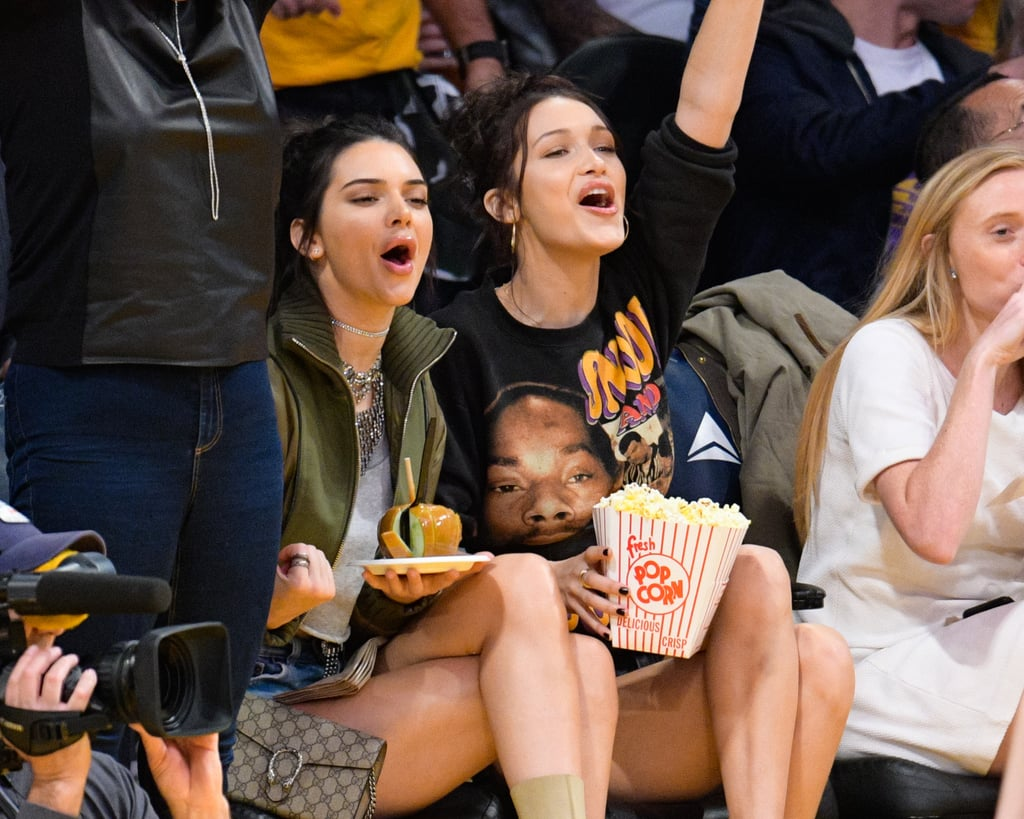 Kendall Jenner and Bella Hadid attended a basketball game between the Dallas Mavericks and the Los Angeles Lakers on Tuesday night at the Staples Center, and judging from the photos, they were having a much better time than the rest of America. The supermodel duo cheered on the home team while munching on candy apples and popcorn, posed for pictures with fans throughout the night, and held hands as they made their way out of the arena. Although Kendall is usually spotted out and about with her BFF and Bella's older sister, Gigi Hadid, she and Bella have hung out plenty of times before, including vacationing together in August.      Related:                                                                                                           Kendall Jenner's Hottest Bikini Pictures