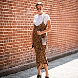 When a slip dress feels too bare, layer a t-shirt underneath.