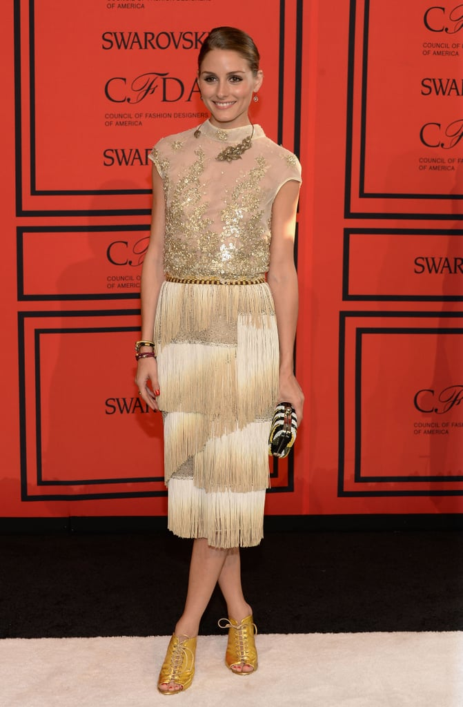 At the 2013 CFDA Awards held in NYC, Olivia Palermo's Dennis Basso golden fringe dress was highlighted by matching gold, lace-up peep-toe booties.