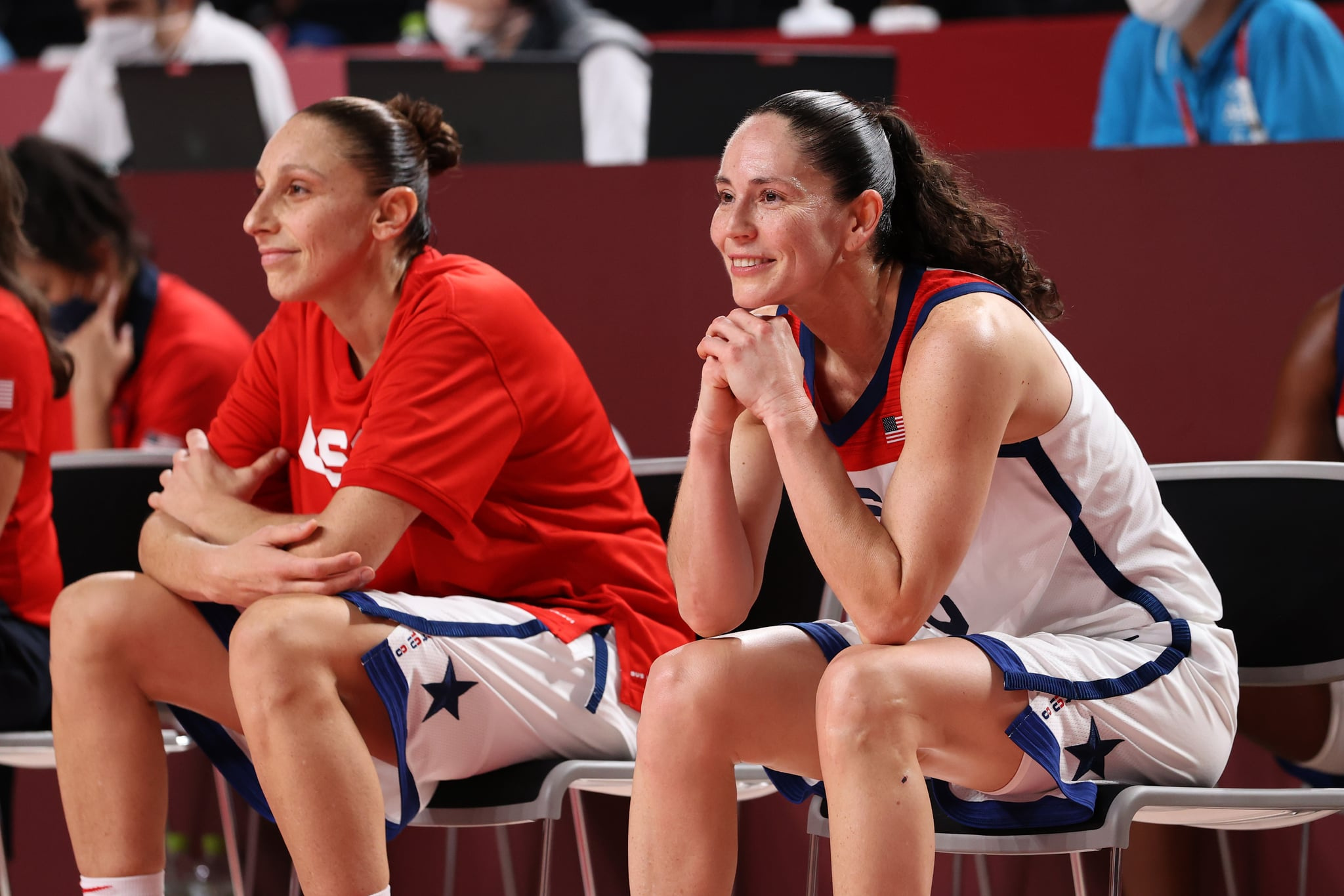 SAITAMA, JAPAN - AUGUST 08: Sue Bird #6 and Diana Taurasi #12 of Team United States share react in celebration from the bench during the second half of the Women's Basketball final game between Team United States and Team Japan on day sixteen of the 2020 Tokyo Olympic games at Saitama Super Arena on August 08, 2021 in Saitama, Japan. (Photo by Gregory Shamus/Getty Images)
