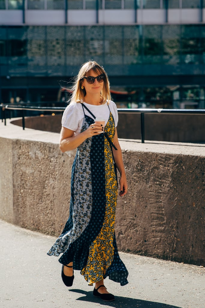 Layer a brightly printed slip dress over a white tee.