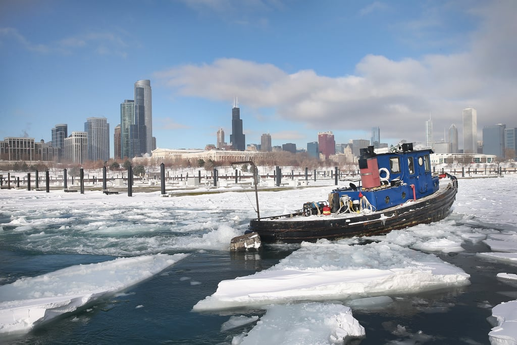 chicago winter a tugboat broke up the ice near downtown chicago winter storm